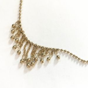 Jewelry - 3/$30!! Gold necklace with hanging chain feature